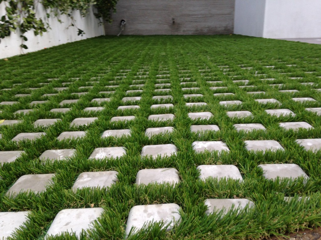 how to fix artificial grass to soil